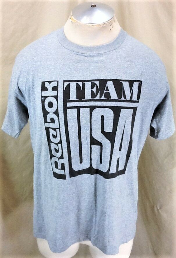 Vintage 90's Reebok Team USA (Large) Retro Olympic Games Graphic T-Shirt Grau