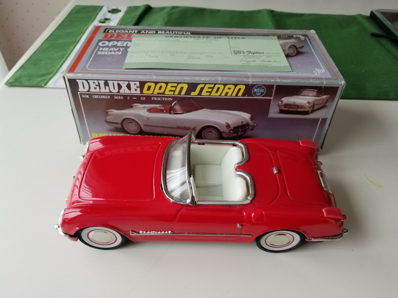 Fifties friction tin car, Chevy Corvette with title.   brand new.
