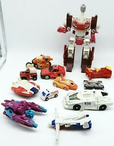 12 ~ Vintage 1980's Hasbro TRANSFORMERS Lot Cars / Trucks / Jet / Cassette / Etc