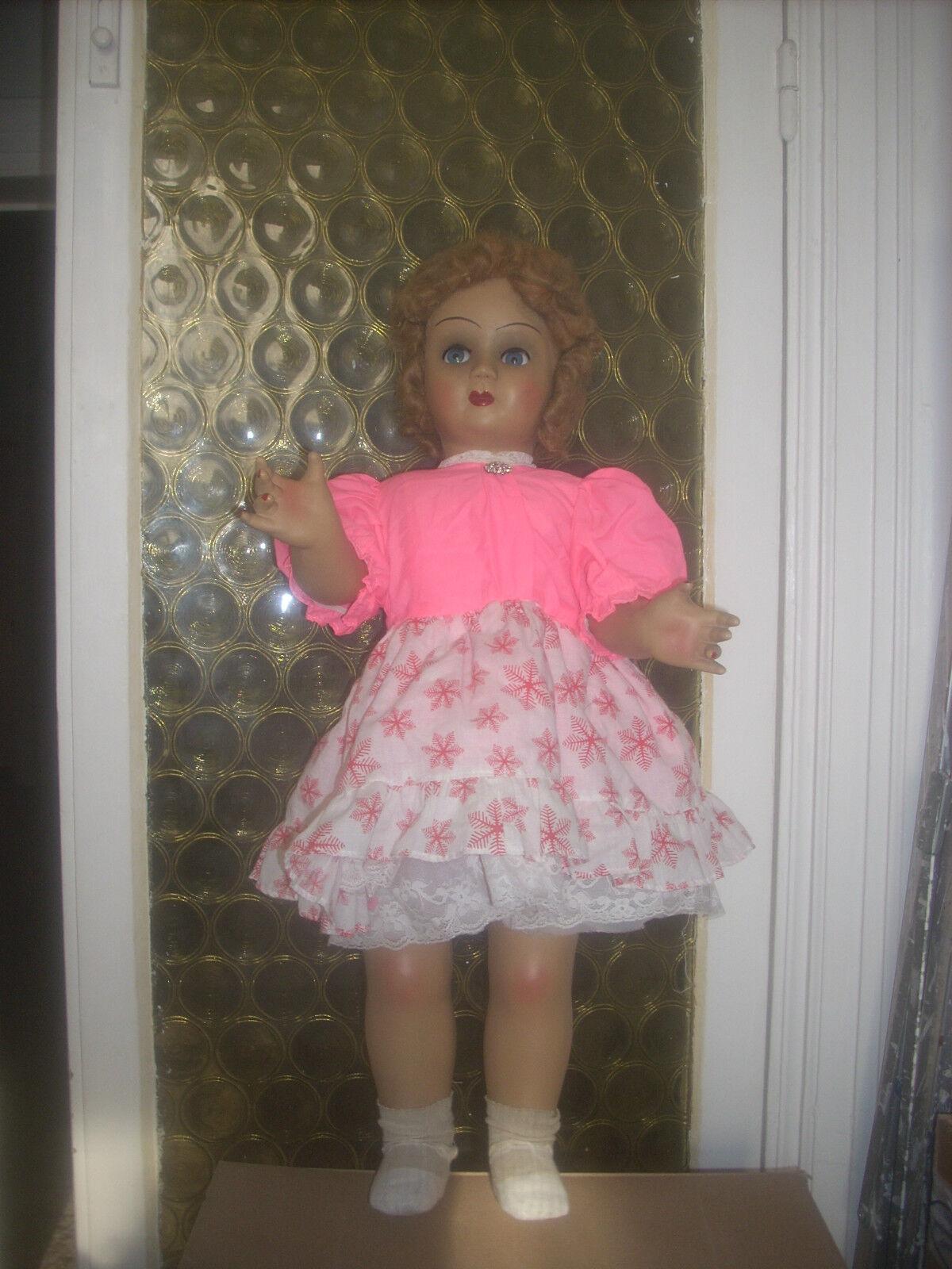 Bambola antica  60-.65  leggi....