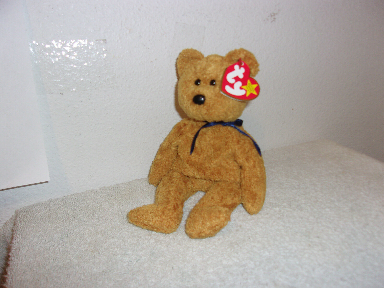 TY   BEANIE BABIES.  FUZZ  D.O.B..JULY. 23, 1998   RETIRED..