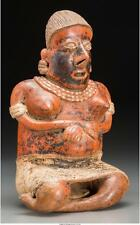 A NAYARIT SEATED WOMAN C. 200 BC - 200 AD SEATED WITH LEGS TUCKE... Lot 70273