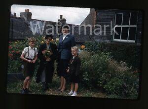 1950s-35mm-red-border-kodachrome-photo-slide-Family-outdoors-Flowers