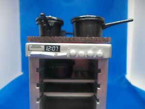 SET-OF-4-BLACK-SAUCEPANS-FOR-A-DOLLS-HOUSE