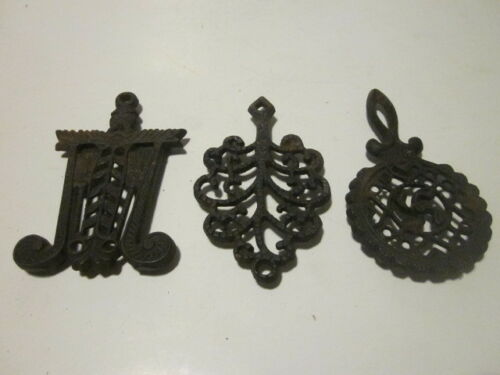 3 VINTAGE ASIAN CAST IRON SMALL TRIVETS PROPELLER,BROOMS & WHEAT & TREE OF LIFE