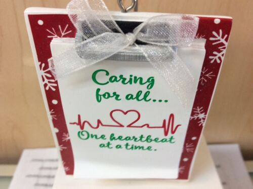 CARING FOR ALL ONE HEARTBEAT AT TIME HALLMARK ORNAMENT NEW W//TAG RESIN NO BOX