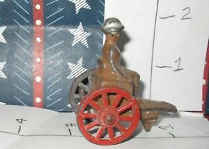 OLD-VINTAGE-LEAD-FIGURES-Sitting-Solider-on-tow-able-two-wheel-carriage-RARE