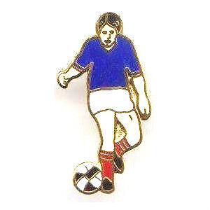 Young boy footballer pin badge Kicking a ball novelty lapel pin.