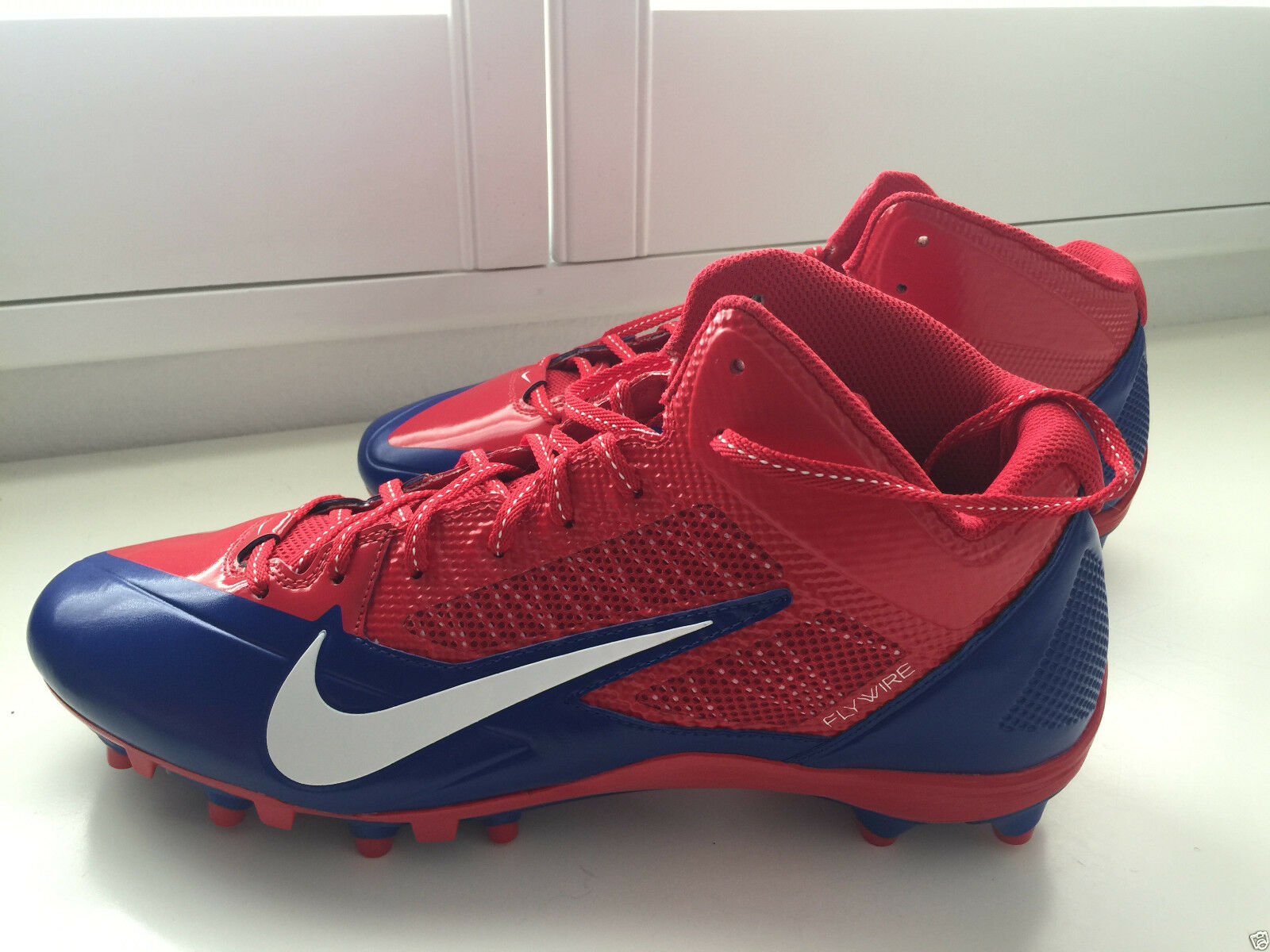 NIKE FLYWIRE RED, WHITE, AND BLUE FOOTBALL CLEATS SIZE 13.5