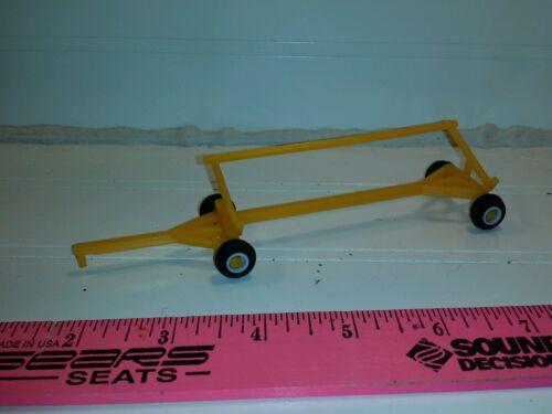1//64 ertl farm toy yellow w// white rims Plastic standi toys header cart trailer