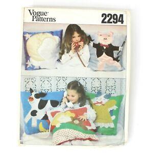 vogue patterns 2294 child's pillow girl bear cat cow pig