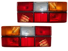 VOLVO 240 244 tail light pair black center molding.new 1372450-449 on SALE TODAY