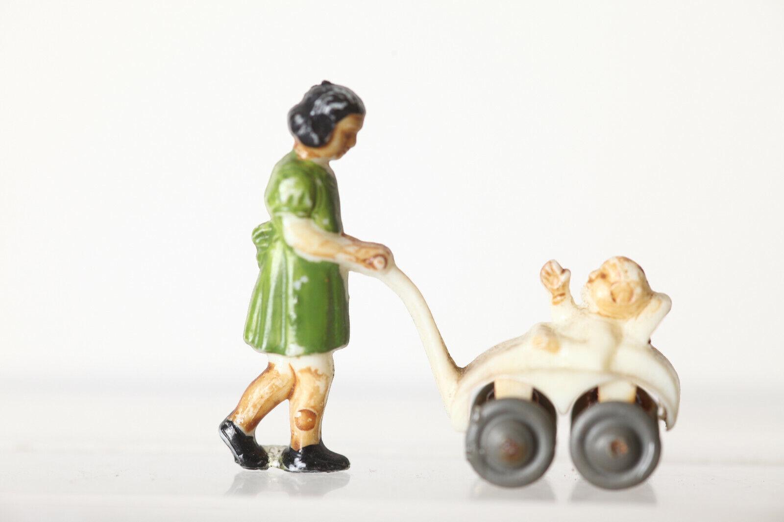 Siku H0 Donna con Bambino in Passeggino 133974