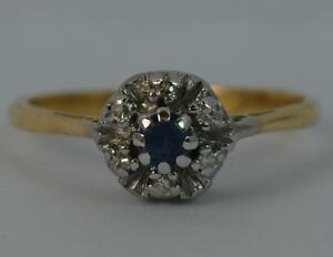 Hallmarked-18-Carat-Gold-Sapphire-and-Diamond-Cluster-Ring-p0459