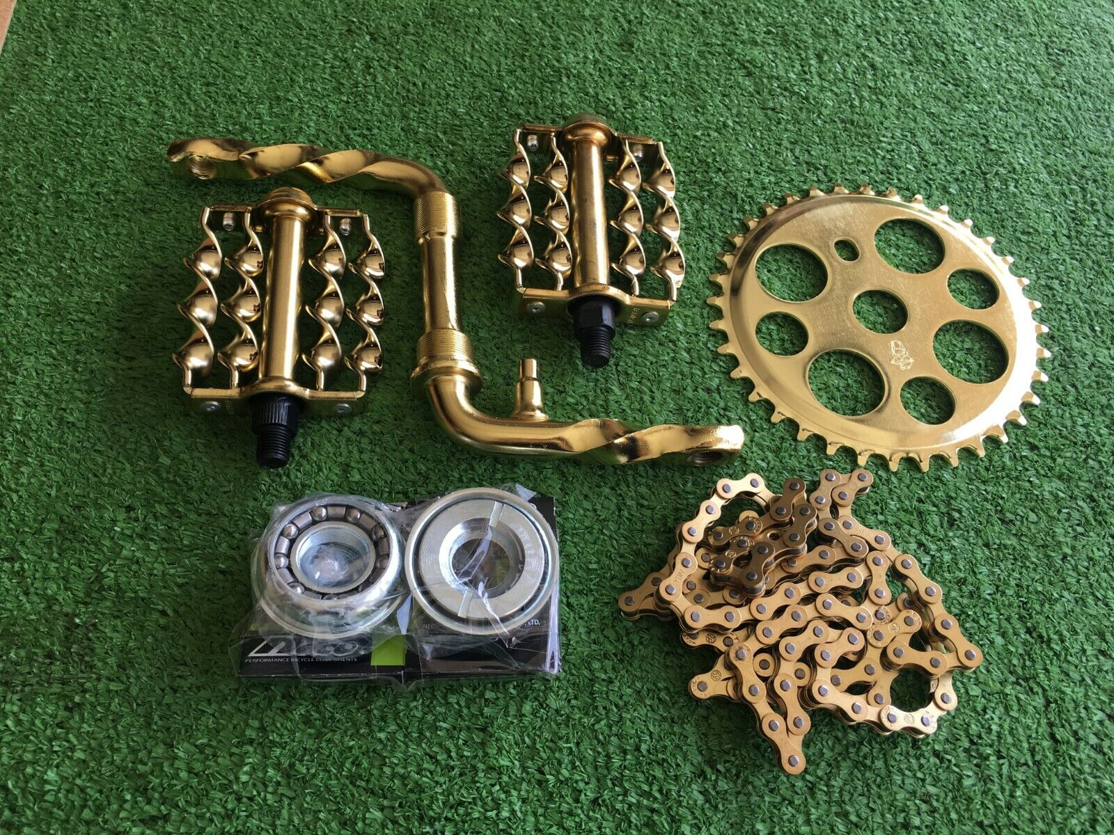 BIKE LOW RIDER 5  gold  ITEMS  TWISTED 4 1 2   CRANK, PEDALS, CHAIN, 36T SPRKT,  official quality
