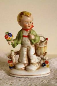 Boy at Fence Holding Basket of Flowers 4 in Figurine Fairing Germany 20469 1800s
