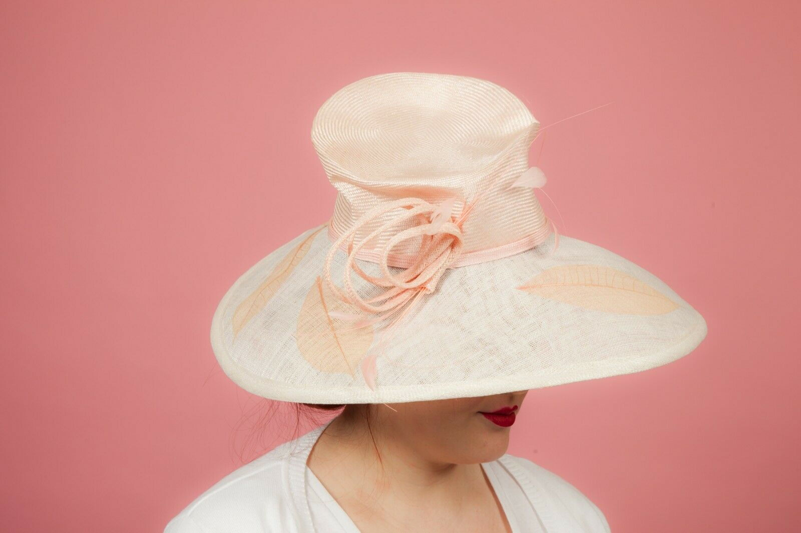 Oversized pink and cream feathered leaf print formal hat by Whitley