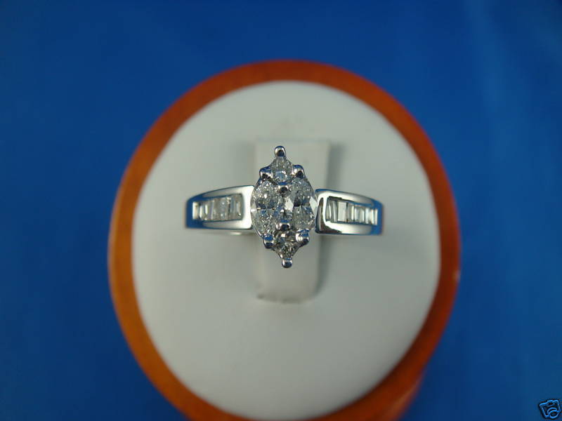 14K WHITE gold AND 0.60 CT T.W. GENUINE DIAMONDS ENGAGEMENT RING.