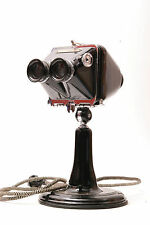 Ritter Intra-oral stereoscope and diagnostic dental lamp.