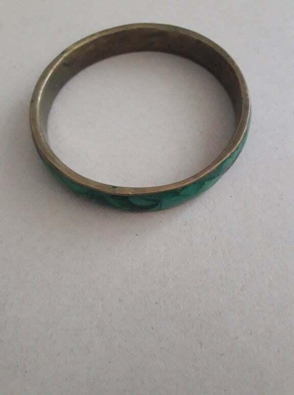 silver bracelet set with oval cabochon malachite stones within a burr-wood presentation case                                       .