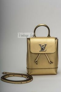 962763af60c7 LOUIS VUITTON New In Box Lock Me Backpack Mini Gold LV121512RO