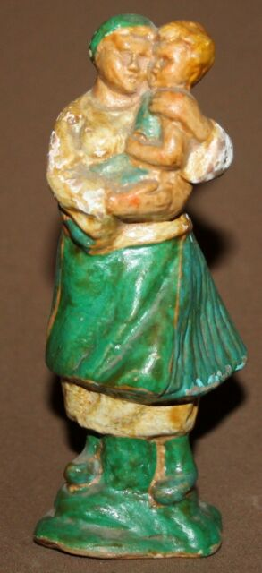 Vintage hand made folk pottery woman with child figurine