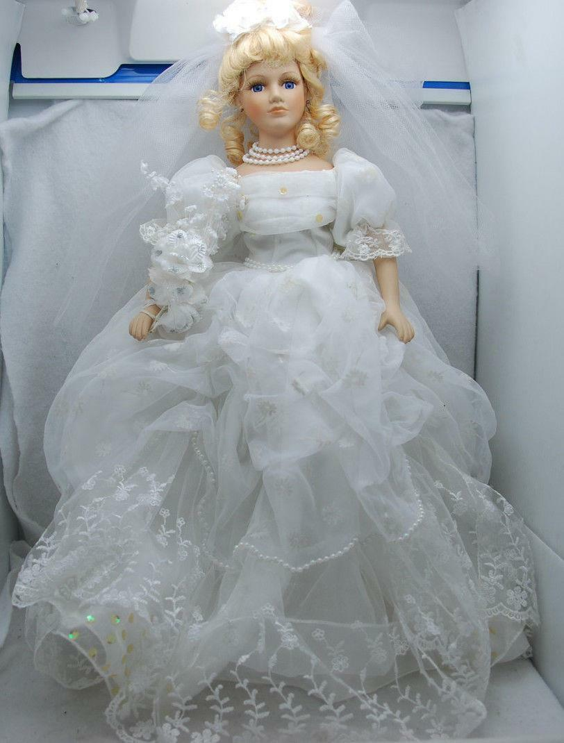 21  COLLECTORS CHOICE PORCELAIN BRIDE WITH VEIL DOLL