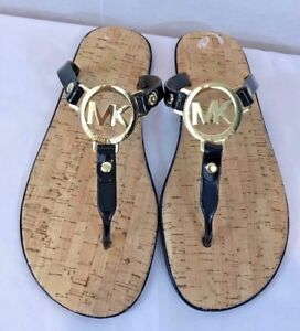 84738a2067ce Michael Kors black gold MK logo charm jelly cork flip flop sandals ...