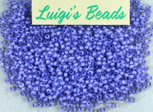 11//0 Round TOHO Japanese Glass Seed Beads #977-Crystal//Neon Purple Lined 10g