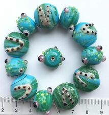 12 x Turq.blue / green, swirly, lampwork glass beads, round/ disc 50 gms    11