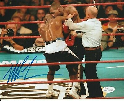 A Mike Tyson And Evander Holyfield Duel Signed And Framed Boxing Photograph