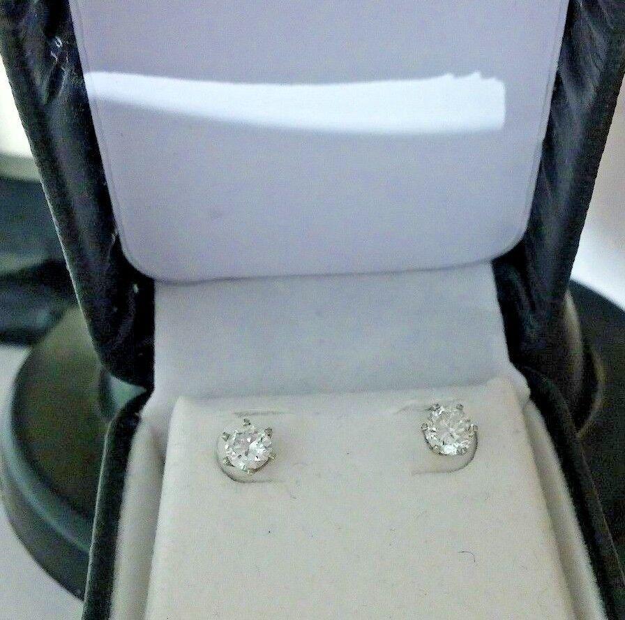 14kt gold & Diamond Stud Earrings .75 pt Earth Mined Natural & appraisal