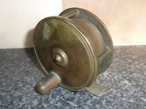 VINTAGE-HEAVY-BRASS-FISHING-REEL-3-034-DIAMETER-WITH-FIXED-RATCHET