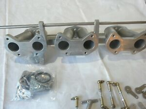 Triumph-TR6-one-piece-triple-weber-inlet-manifold-with-linkages-and-misabs