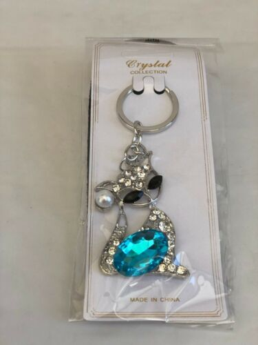 SILVER METALIC KEYS CHAIN  with BLACK EYES  CAT MIX COLOR