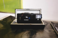 Olympus XA2 with D-Zuiko 35mm f/3.5 + Box strap A11 flash and documents