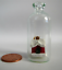 """Miniature Holiday Winter Trinket Toy in Blown Glass Bottle Jug 2/"""" Tall NEW"""