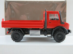 Busch-51007-Mercedes-Benz-Unimog-U-5023-Pritsche-2014-in-rot-1-87-H0-NEU-OVP