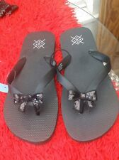 Fun pair of ladies UK 10 / EUR 44 black wide flipflops with a sequin bow detail