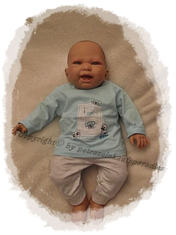 Doro Dolls Babypuppe m. Zähnchen Stoffkörper