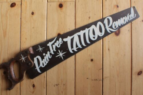 """Saucy Saw Sign /""""Pain Free Tattoo Removal/"""" Plaque Barber Shop VW Man Cave"""
