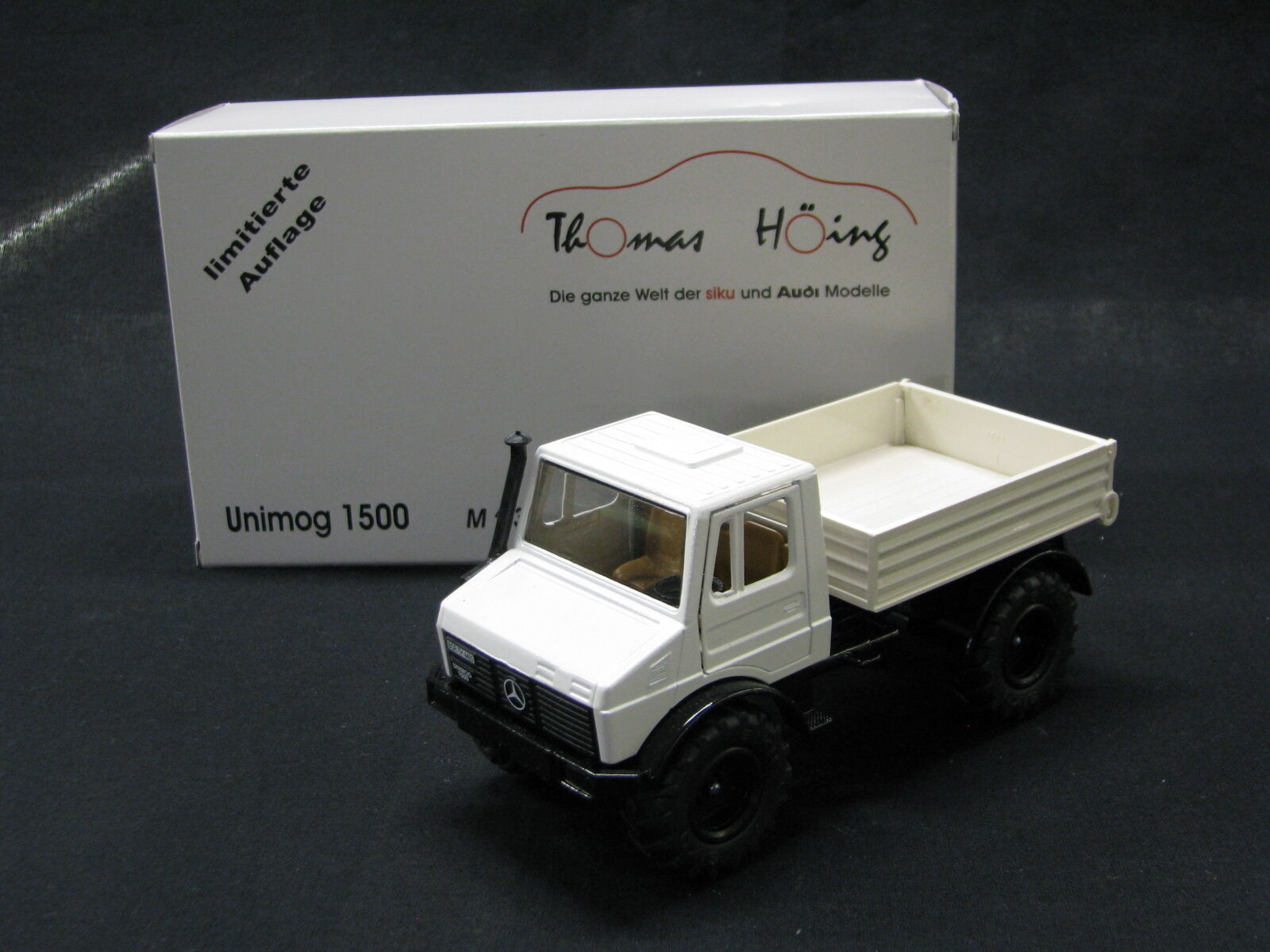 Siku Mercedes-Benz Unimog 1500 1:32 bianca  JS