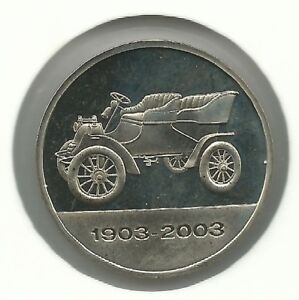 Model-A-1903-on-a-alpaca-medal-issued-for-Ford-Motor-Company-100-years-1903-2003