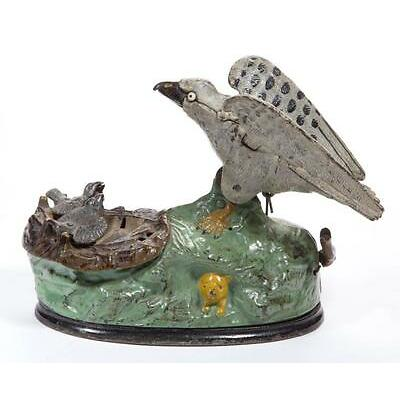 1002. EAGLE AND EAGLETS CAST-IRON MECHANICAL BANK Lot 1002