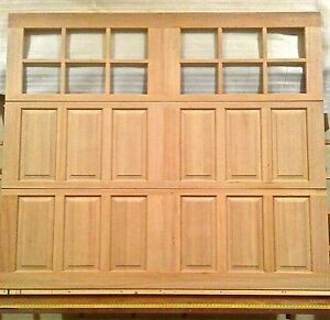 8x7 wood carriage house overhead garage door amanadoors for 10x7 garage door