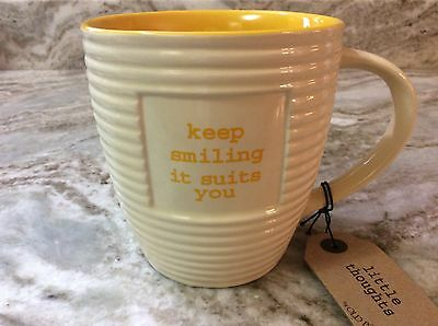Coffee Mug. Old Pottery Company. Keep Smiling. 20 Ounces. Yellow Inside. New.