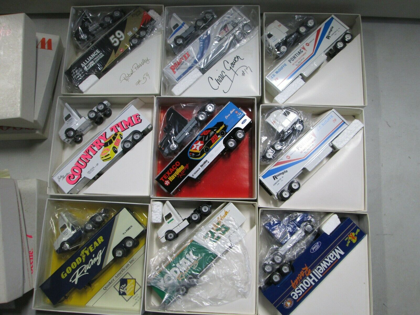 9 Assorted Winross Nascar Transporters (5)