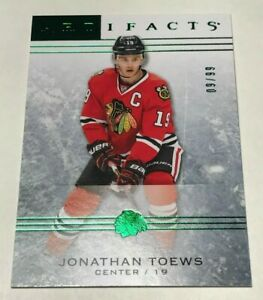 Jonathan-Toews-99-made-Artifacts-Emerald-Insert-Parallel-Hockey-Card-46-Chicago