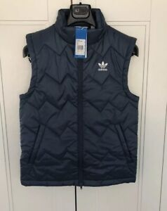 Adidas SST Puffy Vest Tech Ink: : Vêtements et