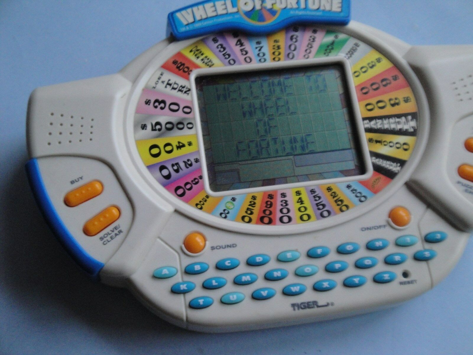 Tiger Handheld Electronic WHEEL OF FORTUNE 1998 With Expansion Cartridge.